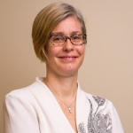 Dr Caprice Greenberg